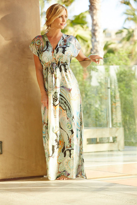 The pool party, the beach, the afternoon tea! What inspired us to create the Maxi is showing the full beauty of this art on a newly developed fabric we created of Poly modal, with a silk feel and look. Dressing it up or wearing it casual, you will love the way you look & feel! Soft and flowing with a relaxed cut, and a tie to cinch in below the bust showing off your finest features.  V Neck Side slit Cap Sleeve Sizing 1 (2-6)   2 (6-10)    3 (12-16)