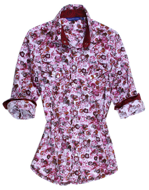 Gorgeous you will be in this Georg Roth fashion!  Beautiful and bold, stunning and sophisticated!  Every tone of pinks, and magenta this lovely floral is on our finest imported European stretch fabric.  Loaded with detail and so versatile it will take you anywhere from day to evening. Full of embellishments that make this shirt a style of it's own. The inside collar stand and cuffs when rolled are in a magenta complimentary and subdued print.  Two slant pockets are adorned with the mother of pearl buttons that run down the front placket and the hemline is a double zig-zag stitch to complete this very classy and updated style.  Just as is or with jewelry or a scarf you will absolutely look dazzling! 97% Cotton / 3% Elasthan