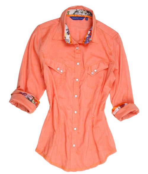 "Any gal with an ""eye on fashion"" will absolutely have to have this stunning and sophisticated shirt blouse.  The color is a beautiful apricot  with a print enhancement on the collar stand and cuffs that compliments this beauty to the utmost.  Also, you will notice there are two slanted pockets with double buttons and all of the buttons are of mother of pearl.  The hem line is a zig-zag double stitch giving it that very special finished appeal.  The fabric is a 100% cotton and is of imported European fabric.  In  true Georg Roth fashion the fit is to perfection.  Don't lose out on this one.  100 % Cotton"