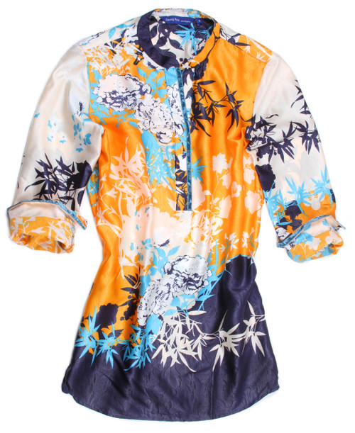 Crisp & clean beautiful tropical print to mix with White bottoms or even denim. Just pop it over the head and let it flow. Relaxed flowing fit  100% Silk Pop Over Tunic