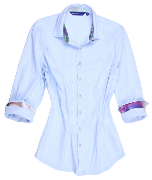 Carefree and casual............subtle and stunning!!  This beautiful delicate powder blue shirt is awesome as it is or you can have so much fun dressing it up with your own jewelry or a scarf.  The collar stand and inside cuffs are embellished with a most complimentary soft print in purples and blues and the hem line is finished in a double zig-zag stitching.  So very clean and fresh!.  It will go with so much for any time of the day or evening.  You will fall in love with our imported European fabric.  It is cool, crisp with just enough of a stretch to make it easy and comfy in any weather.  This is a gem of a shirt that will be a great addition to your wardrobe.   75% Cotton / 21% Polyamid / 4% Elastane Super Stretch