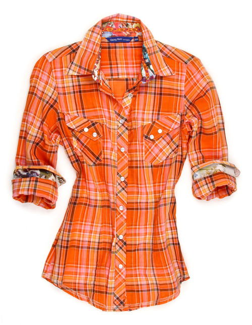Soft Cotton plaid in orange with Liberty of London floral contrast in collar & cuffs. Detailed with an orange satin ribbon in the collar. 2 diagonal flap pockets with snap closure.