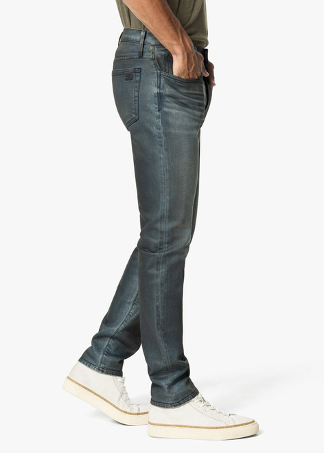 "The Asher limited edition By Joes Jean has a slim fit in premium stretch denim featuring a dark indigo wash that's been faded to look like it's been worn for years. Whiskering and weathered creasing accent the five-pocket design, enhancing the pair's authentic character.  10""rise 34"" inseam"