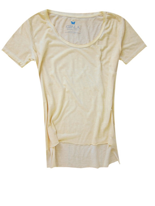 Relaxed and easy short sleeve with a deep scoop neck garment dyed in soft shade of yellow. 100% Organic Cotton. The front is shorter with an unfinished hem. Slightly fitted at the waist  Machine wash or hand wash cold water - no bleach  Lay flat to dry