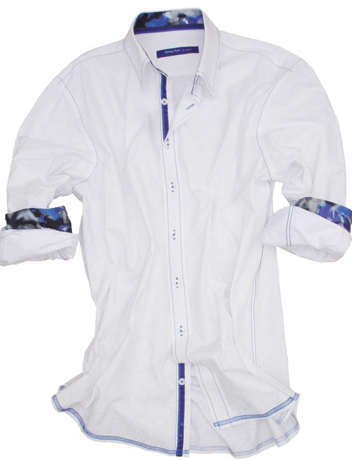 You like to look good without trying hard, and that's where this brisk white tone on tone long sleeve shirt comes in. Detailed with a Liberty of London fantasy print in shades of blue inside the collar stand and cuffs. Finishing touches of a blue striped ribbon inside the collar stand and inside front placket. All seams are done to perfection with contrast stitching in blue.