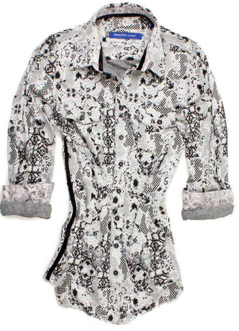 "This ""Cookies N Cream"" knitted jersey long sleeve blouse is detailed with a black crushed velvet ribbon inside the collar stand and completed by 2 breast pockets with button closure. All seams are done to perfection with stitching in ivory.  93% Viscose, 7% Elastane"