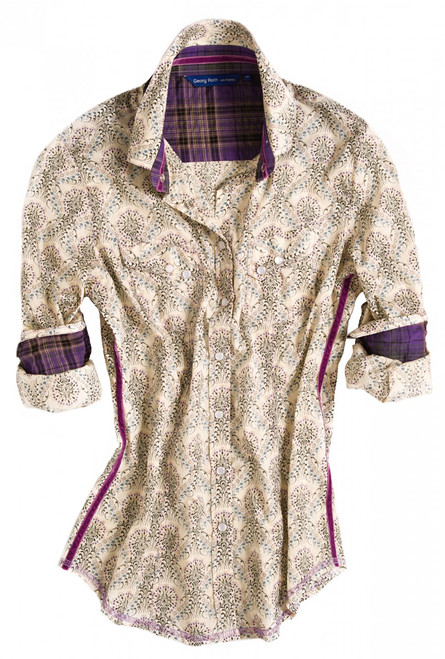 Watch your wardrobe bloom with this gorgeous Liberty of London lilac, blue & black ornament print. Contrasted with purple plaid in collar & cuffs. Detailed with a magenta crushed velvet ribbon in collar and down left & right side. Finishing touches of a Liberty of London fantasy floral print on the outer collar stand. All seams with contrast stitching in lilac. Completed by 2 diagonal flap pockets with snap closure.
