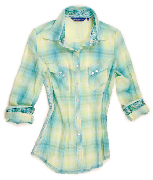 Perfect your wardrobe with this chic ombre long sleeve plaid blouse. The plaid in shades of neon turquoise and neon yellow is detailed with a turquoise & aquamarine Liberty of London fantasy tropical print inside the collar stand and cuffs. Completed by 2 diagonal breast pockets with snap closure. Finishing touches of an aquamarine crushed velvet ribbon inside the collar stand and down right side. All seams are done to perfection with contrast stitching in aquamarine.