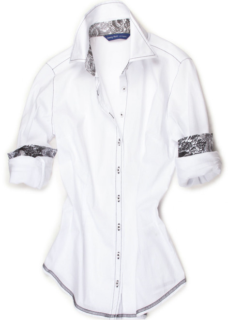 Stretch in crisp White. Inner collar stand and cuffs are embellished with a Liberty of London Charcoal, black, grey and white floral print. All seams are stitched in charcoal with a zig zag finish hem.