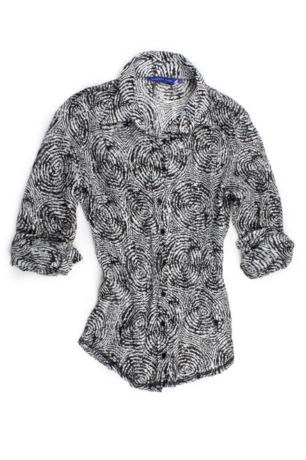 What to wear, what to wear?? You want to be dressed and not overly dressed this is the perfect feel great blouse. Dressed up or worn casual with a pair of jeans, this blouse takes your wardrobe in any direction! Chiffon pattern swirl in black and white with a small sequin pattern.