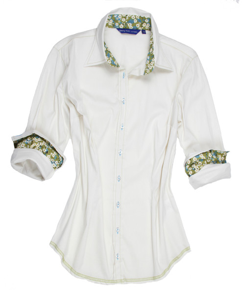 Charming in every way. A stunning cream stretch with Liberty of London floral motif contrast in the collar & cuffs. All seams are finished with contrast stitching in green.  69% Cotton, 27% Polyamide, 4% Elastane
