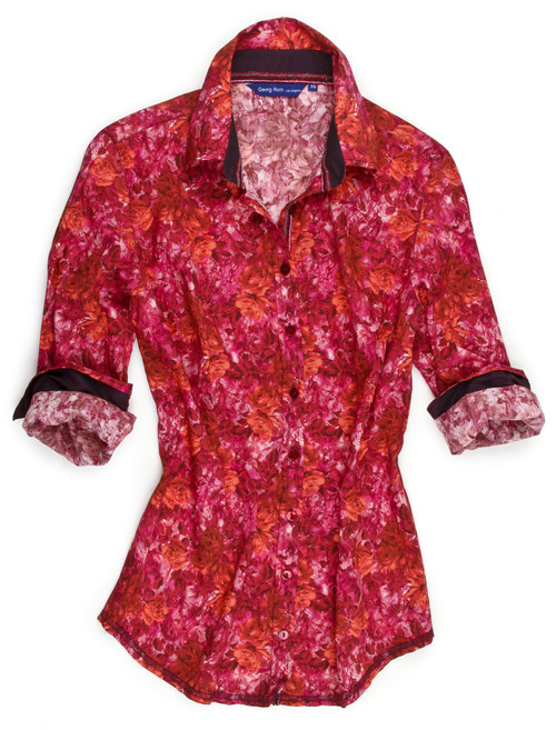 A play on pattern makes this blouse truly an artists masterpiece. Stunning rose pattern in autumn shades of Orange, magenta and fuchsia paired with a magenta paisley print. A finishing touch of a peek a boo fuchsia satin under the collar stand and a crushed velvet trim inside the front placket. 4 button cuffs make the perfect roll! 100% Cotton