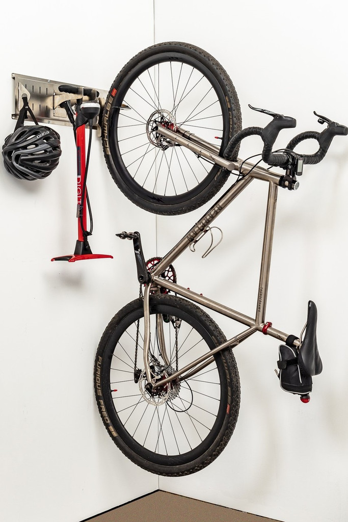 Vertical bike storage, bike pump storage, and helmet storage