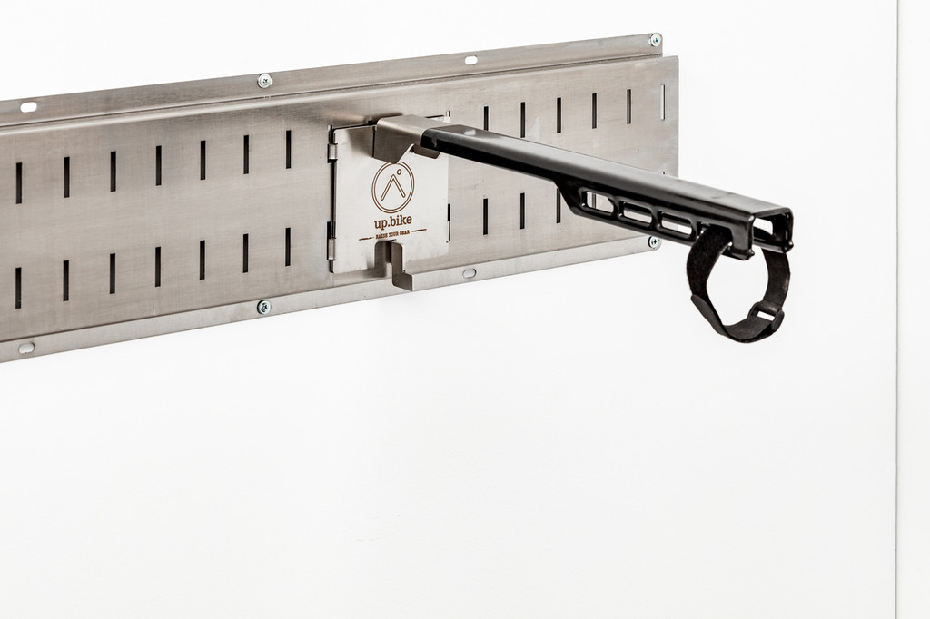 Great for hanging your bike quickly from the nose of the seat, or for sliding extra tubes, tires, rims or wheelsets for storage.  The supplied velcro strap can secure them, and this is also used to stabilze bikes for wheel-on mobile storage in our Team Trailer.