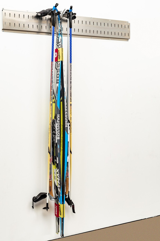 Vertical Ski Storage - store one set of Alpine or Two sets of Nordic skis, and configure the system to work with your seasons.