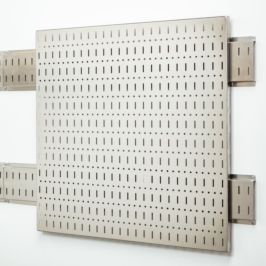 Works with all of our accessories and tool mounts.  Does not include the long pictured rails, does include mouting pads for the tool panel.  Row of traditional peg board holes between the slotted features.