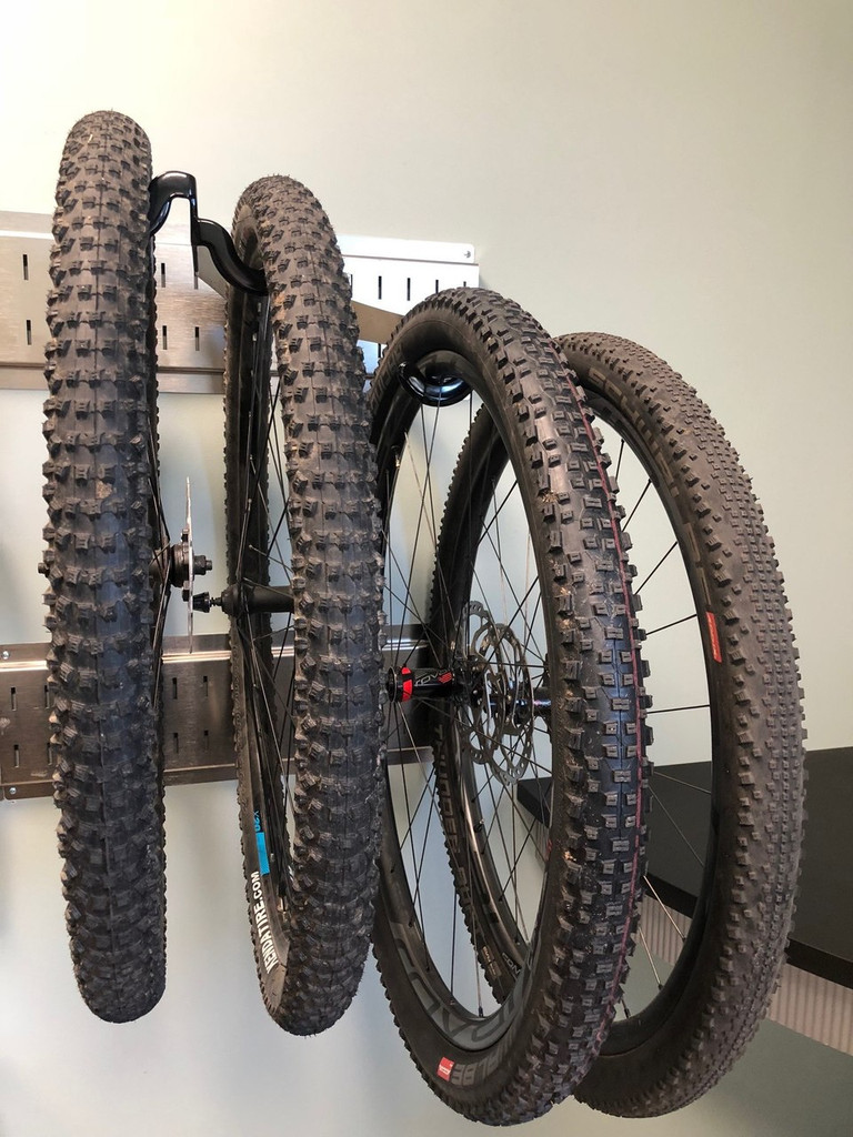 Valuable wheelsets off the ground.  Coated hooks protect your rims, and you're organized and damage free with your extra wheelsets.  Fit 2 wheelsets per hanger.