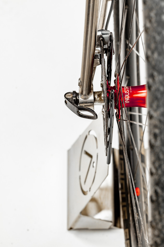 Proper application - how it works.  Nice depth-of-field use and pop of red from the Industry 9 hubs in this portable bicycle stand.