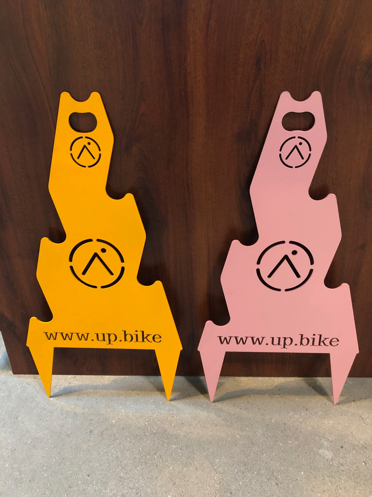 "Available in ""Up.bike Orange"" or ""Ellen Noble Pink""!"