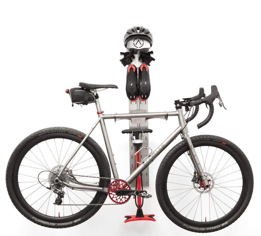 An efficient, elegant cycling storage center.  Helmet, pump, kit, and bike, ready for last-minute tweaks before your next ride.