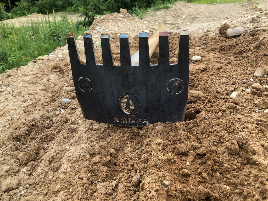 Our trail rake with edge for digging mountain bike trails and tines for raking out rocks and roots during your bicycle trail construction project.