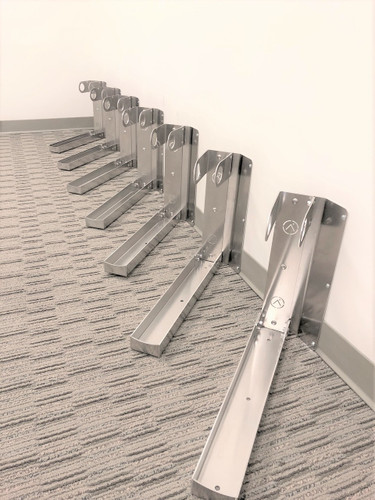 Roll-in ground-level bicycle storage, for 1 bike on up.  No lifting required, fits a wide variety of tire sizes (but not all fat tires).