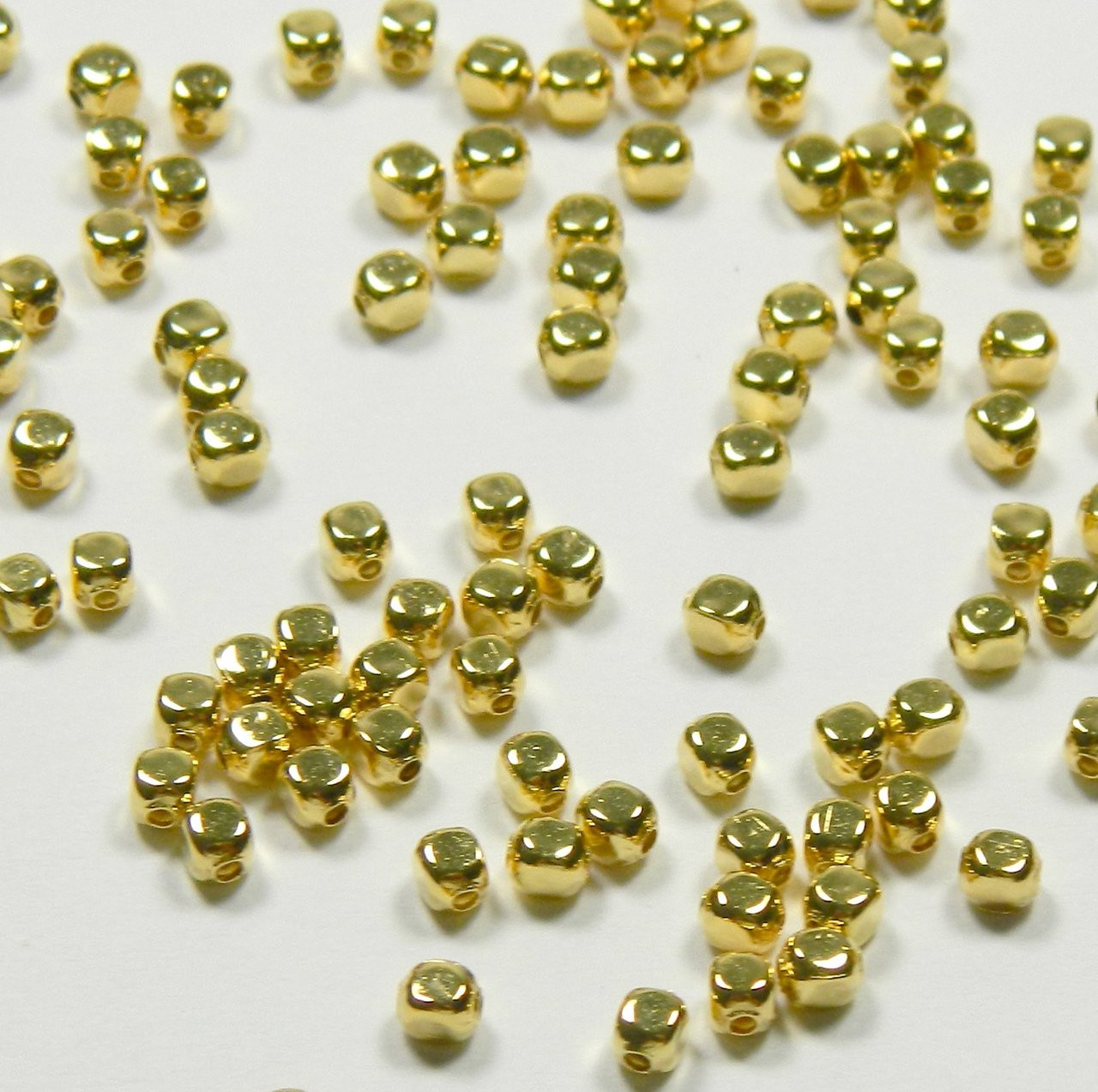 100 Spacer bead gold plated over brass smooth oval 5x3mm