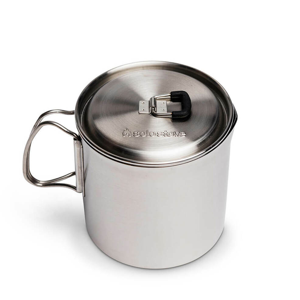The Solo Stove Pot 900 has a lockable  rubber coated tab and fold out handles.