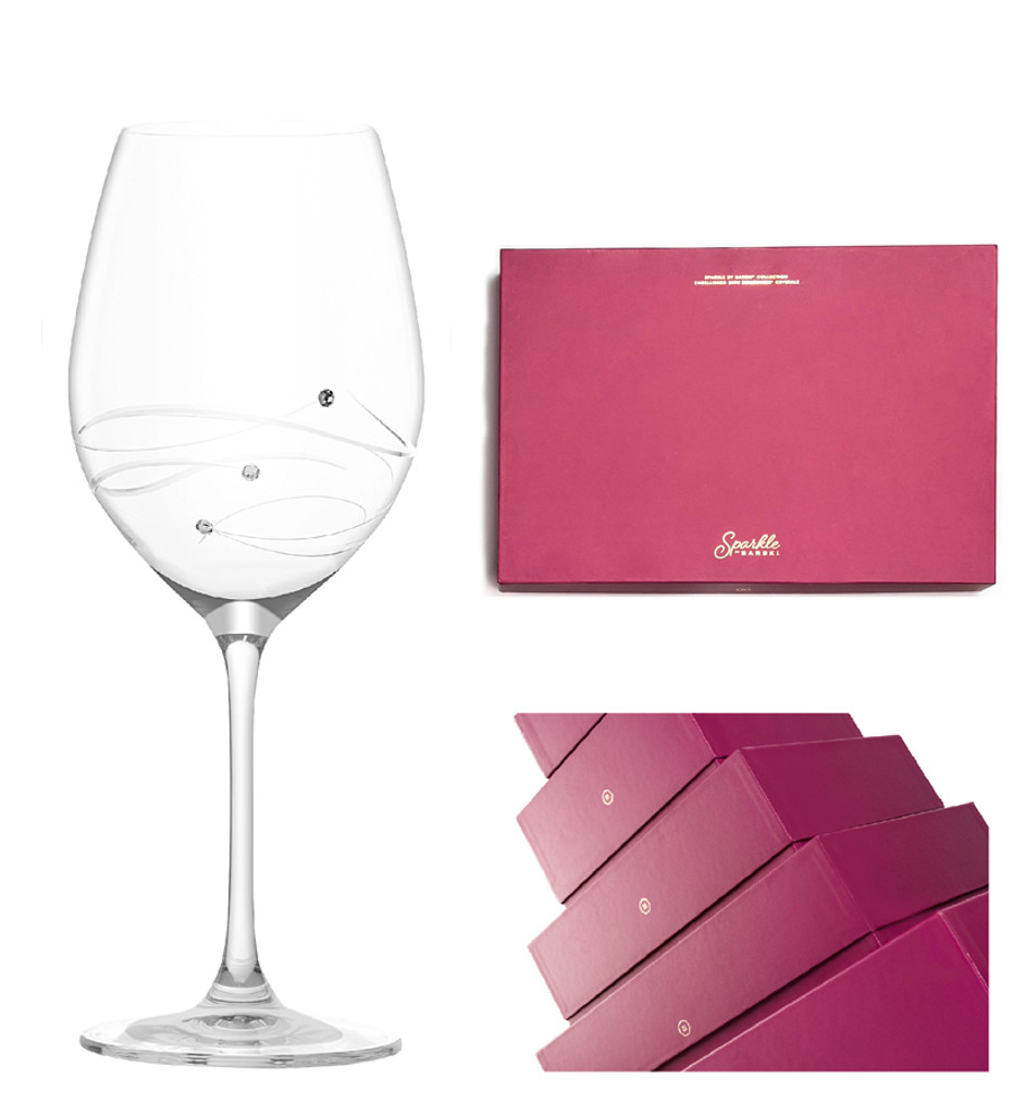 Elegant red presentation box included.