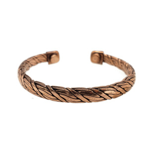 Handwoven copper bracelet with magnets at end for energetic healing.