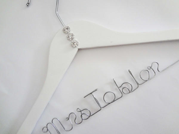 White hanger with Rhinestone buttons, no bow