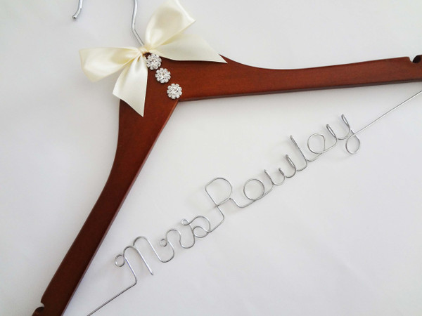 Walnut hanger with Rhinestone buttons, and Ivory bow