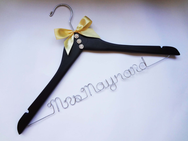 Black hanger with Rhinestone buttons, and Gold bow