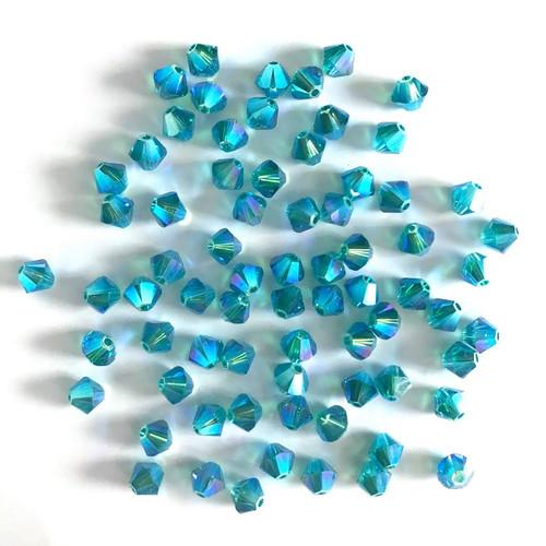 On Hand: Swarovski 5328 4mm Xilion Bicone Beads Blue Zircon AB 2X   (72 pieces)