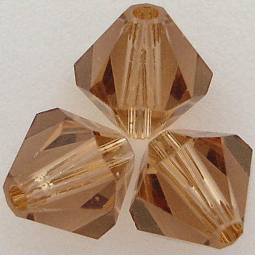 Swarovski 5328 5mm Xilion Bicone Beads Light Smoked Topaz
