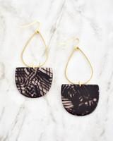 Emmy Earrings - Black on marble background