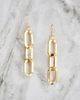 Electra Chain Earrings on marble background