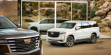 Two Cadillac® Escalades parked in desert