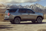 Gray Chevrolet Tahoe parked with mountains