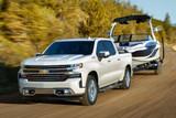 White Chevrolet Silverado towing boat