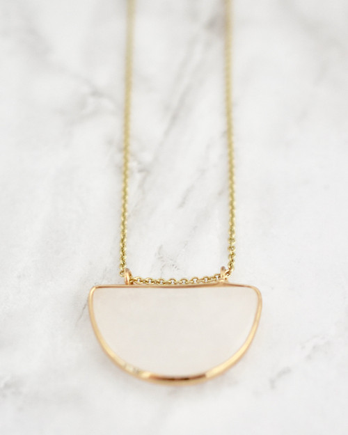 Olivia Necklace - Crystal on marble background