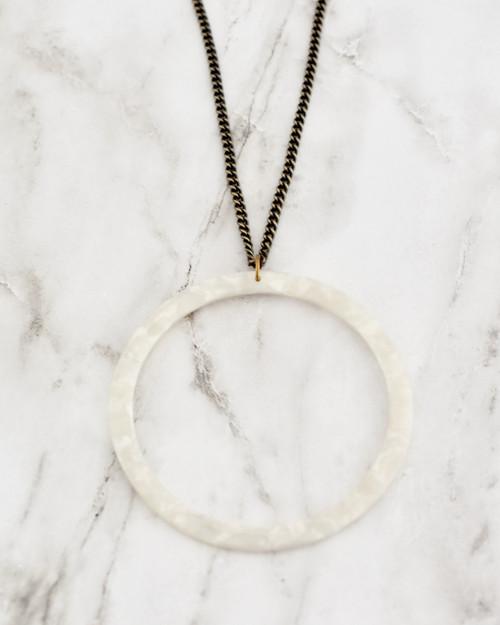 Keaton Necklace - White on marble background