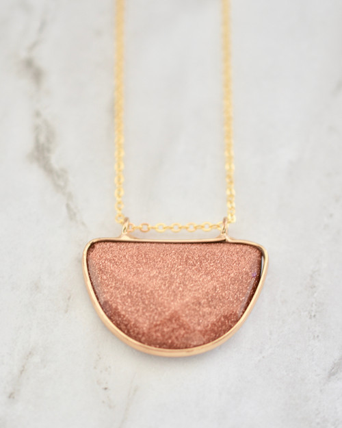 Olivia Necklace - Rust on marble background