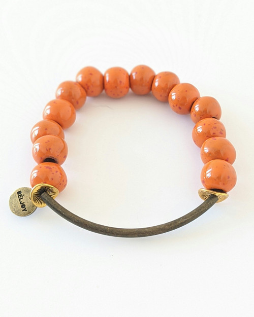 Buffy Clay Bracelet -Orange Speck on white background