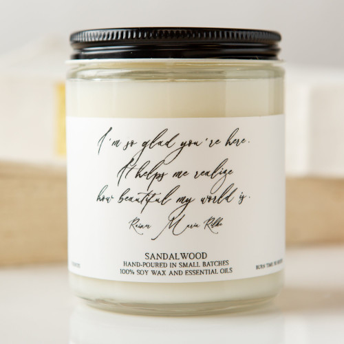 Sandalwood candle with quote:  I'm so glad you're here. It helps me realize how beautiful my world is.—Rainer Maria Rilke