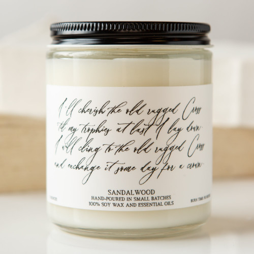 Sandalwood candle with hymn lyrics:  I'll cherish the old rugged Cross til my trophies at last I lay down, I will cling to the old rugged Cross And exchange it some day for a crown.