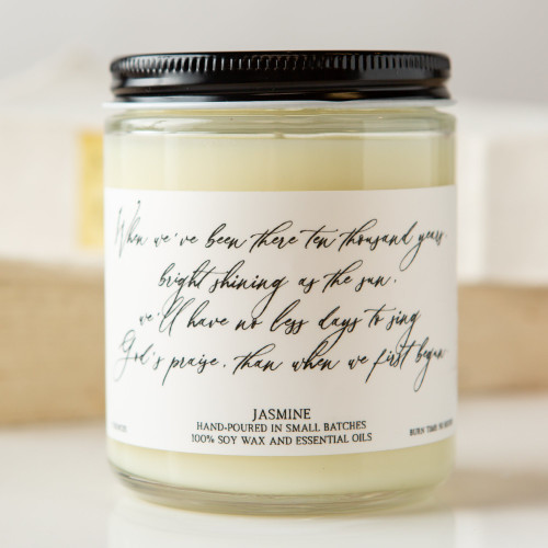 Jasmine candle with hymn lyrics: When we've been there ten thousand years, bright shining as the sun, we'll have no less days to sing God's praise, than when we first begun.