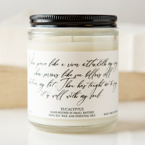 Eucalyptus candle with hymn lyrics: When peace like a river attendeth my way when sorrows like sea billows roll whatever my lot, Thou has taught me to say it is well with my soul