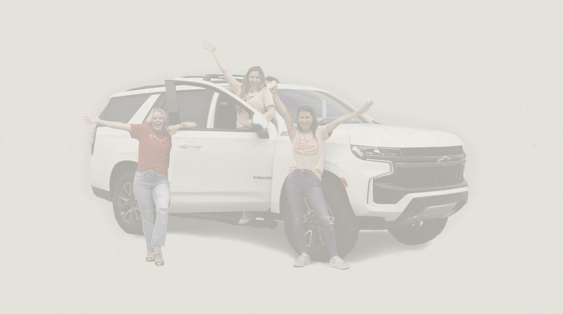 Happy women by an awesome car