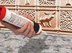 Clear Silicone is the best way to seal your metal backsplash to your contertop.